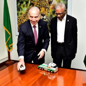 Mr. John Hess presented President David Granger with two HESS model vehicles. In the 1960's the company, in a goodwill gesture, began giving their customers these model toys during the holiday season