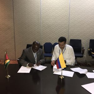 The signing the of the Visa Exemption Agreement by the Hon. Carl Greenidge, Minister of Foreign Affairs.