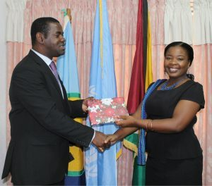 Director of the Multilateral and Global Affairs Department, Troy Torrington hands Ms. Stellingburg a token of appreciation.