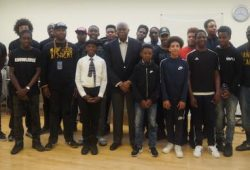PICTURED: Guyana's high commissioner to the UK Hamley Case (centre) with  boys and